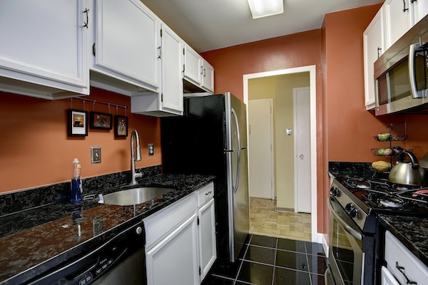 Great space and amenities in glover park condo for Updated galley kitchen photos